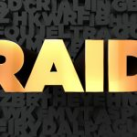 Raid – Gold text on black background – 3D rendered stock picture.